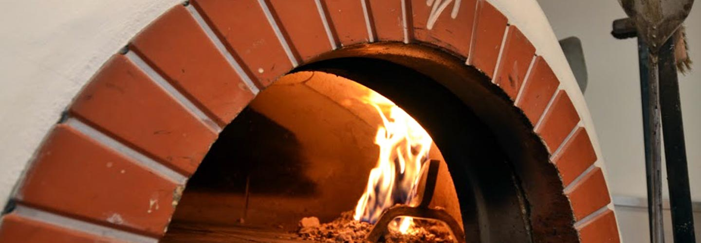 Photo: traditional wood fired pizza oven at the Wild Olive.